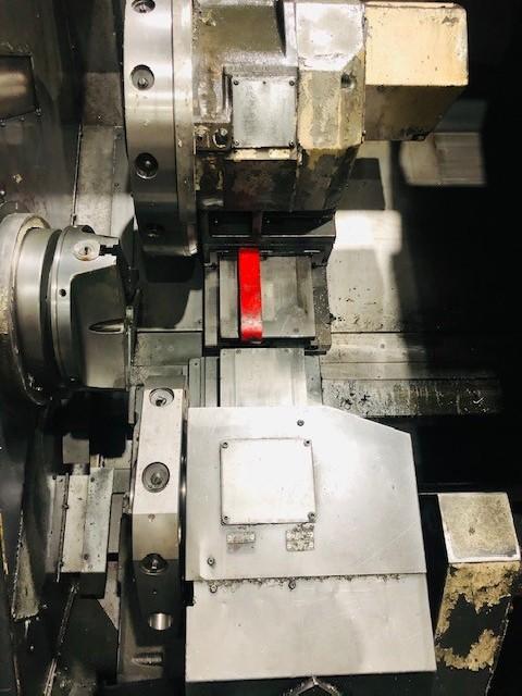 Токарный станок с наклонной станиной с ЧПУ OKUMA LU25 фото на Industry-Pilot