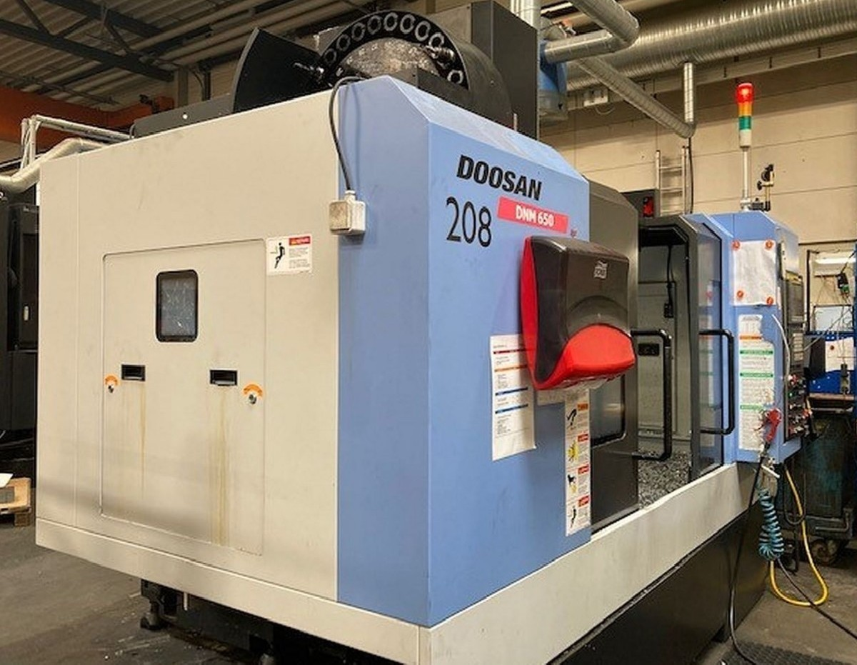 Обрабатывающий центр - вертикальный DOOSAN DNM 650 фото на Industry-Pilot