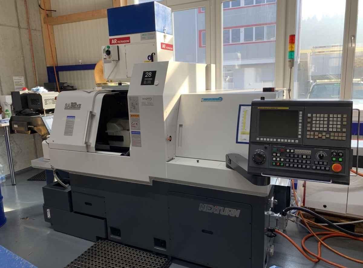 Прутковый токарный автомат продольного точения NEXTURN SA 32 XII-B фото на Industry-Pilot
